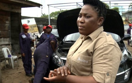 Female Mechanic Grooms Female Students